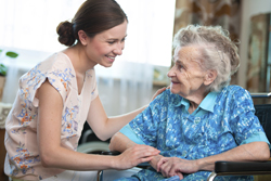 senior woman with home caregiver.jpg